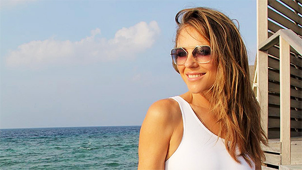 9fba47d03dd0f Elizabeth Hurley is the queen of swimsuits! She showed off her first  one-piece of 2019 in a sultry, new photo! She wore a body-hugging white  bathing suit ...